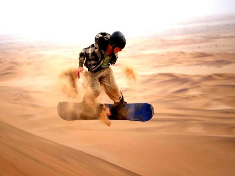 Extreme sports sand boarding